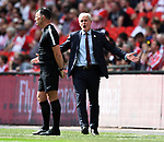 Southampton Manager Mark Hughes appeals to the 4th official Neil Swarbrick during the FA cup semi-final match at Wembley Stadium, London. Picture date 22nd April, 2018. Picture credit should read: Robin Parker/Sportimage