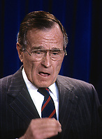 ***FILE PHOTO*** George H.W. Bush Has Passed Away<br /> Washington, DC., USA,  1991<br /> President George H.W. Bush talks with and answers reporters questions during a press briefing in the White House Press briefing room. <br /> CAP/MPI/MRN<br /> &copy;MRN/MPI/Capital Pictures