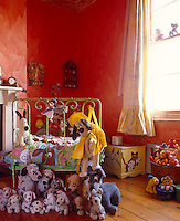A collection of 101 Dalmatians lives under the bed in this bright child's bedroom