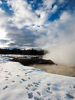 footprints in winter snow around steaming geothermal area near Mud Volcano,Yellowstone National Park, Wyoming, United States of America