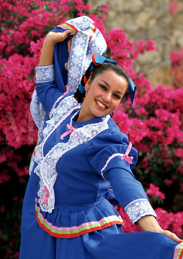 Portrait of a smiling, female Mexican dancer in traditional dress. Mexico.