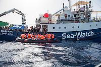 Sea Watch-2.<br /> Die Sea Watch-2 bei ihrer 13. SAR-Mission vor der libyschen Kueste.<br /> Im Bild: Ein Schlauchboot mit Gefluechteten an der Sea Watch-2.<br /> 22.10.2016, Mediterranean Sea<br /> Copyright: Christian-Ditsch.de<br /> [Inhaltsveraendernde Manipulation des Fotos nur nach ausdruecklicher Genehmigung des Fotografen. Vereinbarungen ueber Abtretung von Persoenlichkeitsrechten/Model Release der abgebildeten Person/Personen liegen nicht vor. NO MODEL RELEASE! Nur fuer Redaktionelle Zwecke. Don't publish without copyright Christian-Ditsch.de, Veroeffentlichung nur mit Fotografennennung, sowie gegen Honorar, MwSt. und Beleg. Konto: I N G - D i B a, IBAN DE58500105175400192269, BIC INGDDEFFXXX, Kontakt: post@christian-ditsch.de<br /> Bei der Bearbeitung der Dateiinformationen darf die Urheberkennzeichnung in den EXIF- und  IPTC-Daten nicht entfernt werden, diese sind in digitalen Medien nach §95c UrhG rechtlich geschuetzt. Der Urhebervermerk wird gemaess §13 UrhG verlangt.]