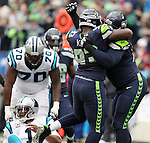 Seattle Seahawks defensive tackle Ahtyba Rubin (77) celebrates a sack over Carolina Panthers quarterback Kam Newton (1) at CenturyLink Field in Seattle on October 18, 2015. The Panthers came from behind with 32 seconds remaining in the 4th Quarter to beat the Seahawks 27-23.  ©2015 Jim Bryant Photography. All Rights Reserved.
