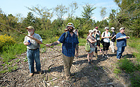 NWA Democrat-Gazette/ANDY SHUPE<br /> Marson Nance (left), director of land protection and stewardship for the Northwest Arkansas Land Trust, points out plants Saturday, Sept. 7, 2019, during a tour of the Wilson Springs Preserve in Fayetteville. The Northwest Arkansas Land Trust has been working for seven years to preserve and restore the 121-acre prairie wetland and opened the area to visitors with Immerse, a nature and arts festival.