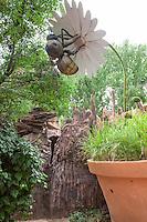 Whimsical bee art, pollinating flower in Childrens' Fantasy Garden at Rio Grande Botanic Garden. Albuquerque, New Mexico