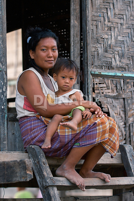 Mother and toddler son on doorstep, Warloka village, Flores.