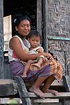 Mother and toddler son on doorstep, Warloka village, Flores.