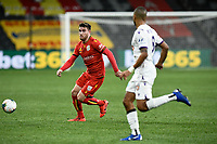 30th July 2020; Bankwest Stadium, Parramatta, New South Wales, Australia; A League Football, Adelaide United versus Perth Glory; Ryan Strain of Adelaide United passes the ball as James Meredith of Perth Glory closes him down
