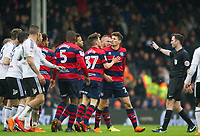 QPR Pawel Wszolek clash with Fulham's players during the Sky Bet Championship match between Fulham and Queens Park Rangers at Craven Cottage, London, England on 17 March 2018. Photo by Andrew Aleksiejczuk / PRiME Media Images.