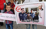 Palestinian supporters of Popular front for Liberation of Palestine (PFLP), take part in a protest in solidarity with jailed Palestinian boy Ahmad Manasrah, in Khan Younis in the southern Gaza Strip, November 26, 2015. The Israeli occupation accuses Ahmad Manasrah, 13, of attempts of murder twice and the possession of a knife. Despite the pressure he suffered during the interrogation, he did not admit to the charges, saying that he only intended to intimidate the settlers. Photo by Abed Rahim Khatib