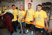 Nathan Remillard, Bennet Sage, Steven Croce and Paul LaGreca do some heavy lifting as they help out at the Seamen's Church Institute in Newport as part of Salve Regina's Exploration Day of Service.