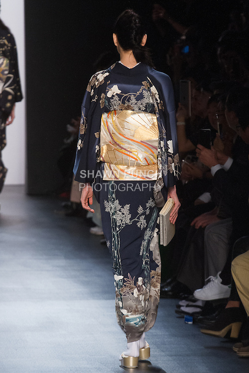 """Model walks runway in an """"Existence of the Universe"""" silk kimono from the Hiromi Asai Fall Winter 2016 """"Spirit of the Earth"""" collection by Hiromi Asai & Kimono Artisan Kyoto, presented at NYFW: The Shows Fall 2016, during New York Fashion Week Fall 2016."""