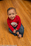 7 month old baby boy sitting full length