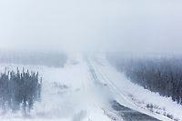 Snow blows behind a truck on the James Dalton Highway, Alaska.