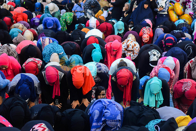 Muslim Egyptians perform the morning prayer of the Eid al-Adha holiday at Amr Ibn al-Aas mosque in the capital Cairo on September 12, 2016. Muslims across the world celebrate the annual festival of Eid al-Adha, or the festival of sacrifice, which marks the end of the Hajj pilgrimage to Mecca and commemorates prophet Abraham's readiness to sacrifice his son to show obedience to God. Photo by Amr Sayed
