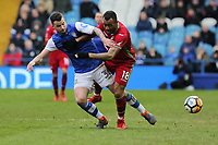 (L-R) Daniel Pudil of Sheffield Wednesday challenges  Jordan Ayew of Swansea City during The Emirates FA Cup Fifth Round match between Sheffield Wednesday and Swansea City at Hillsborough, Sheffield, England, UK. Saturday 17 February 2018