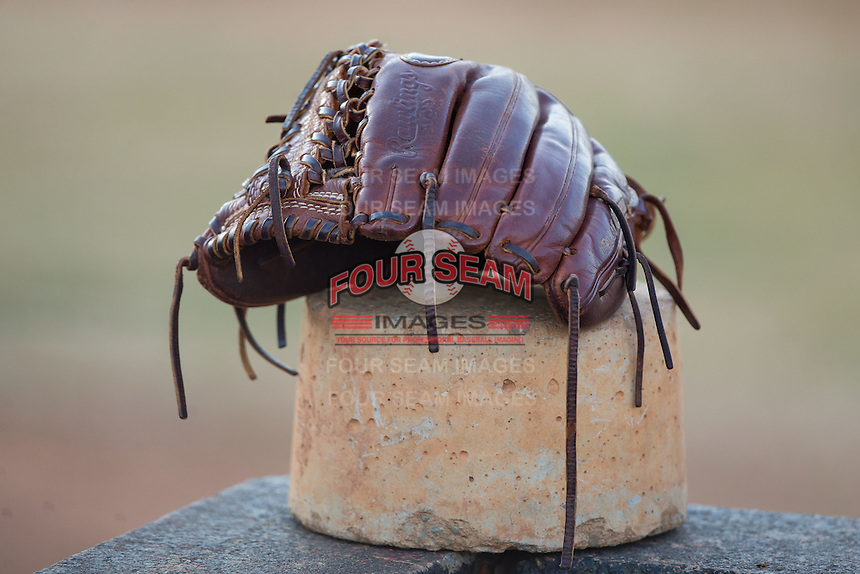 A Rawlings baseball glove sits in the Catawba Indians bullpen prior to the game against the Belmont Abbey Crusaders at Abbey Yard on February 7, 2017 in Belmont, North Carolina.  The Crusaders defeated the Indians 12-9.  (Brian Westerholt/Four Seam Images)