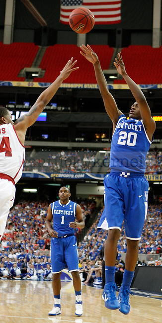 Freshman Doron Lamb shoots against Charvez Davis in the Semifinal round of the 2011 SEC Men's Basketball Tournament, at the Georgia Dome, Saturday, March 12, 2011.