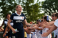 Sky Blue FC defender Melanie Booth (13) greets fans prior to playing the Boston Breakers Sky Blue FC defeated the Boston Breakers 5-1 during a National Women's Soccer League (NWSL) match at Yurcak Field in Piscataway, NJ, on June 1, 2013.