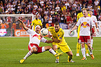 Josh Williams (3) of the Columbus Crew fouls Teemu Tainio (6) of the New York Red Bulls. The New York Red Bulls defeated the Columbus Crew 3-1 during a Major League Soccer (MLS) match at Red Bull Arena in Harrison, NJ, on September 15, 2012.