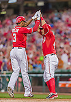 22 August 2015: Washington Nationals outfielder Michael Taylor is greeted at home by catcher Wilson Ramos after hitting a home-run against the Milwaukee Brewers at Nationals Park in Washington, DC. The Nationals defeated the Brewers 6-1 in the second game of their 3-game weekend series. Mandatory Credit: Ed Wolfstein Photo *** RAW (NEF) Image File Available ***