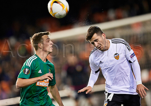 18.02.2016. Mestalla Stadium, Valencia, Spain. Europa League. Valencia versus Rapid Wien. Defender Jose Gaya of Valencia CF (L) heads the ball under pressure from a Rapid Defender