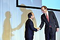 October 15, 2012, Tokyo, Japan - President Masayoshi Son, left, of Japan's  Softbank shakes hands with Dan Hesse, CEO of Sprint Nextel Corp. of U.S. , as they pose for a battery of photographres and TV cameramen at the conclusion of their presentation in Tokyo on Monday, October 15, 2012...Sharp Corp. announced that it is.Softbank and Sprint, the third-largest mobile phone companies in Japan and U.S.respectively, have reached the agreement under which the Japanse mobile company pays $20 billion to acquire a 70% stake in the U.S. cellular phone company, thus creating one of the the leading communications groups in the world with a total of 90 million mobile phone subscriptions.  (Photo by Natsuki Sakai/AFLO) AYF -mis-