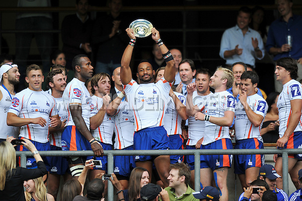 Derek Lipscomb lifts the Plate. World Club 7s on August 18, 2013 at Twickenham Stadium in London, England. Photo by: Patrick Khachfe / Onside Images