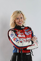 Feb. 22, 2013; Chandler, AZ, USA; NHRA funny car driver Courtney Force poses for a portrait prior to qualifying for the Arizona Nationals at Firebird International Raceway. Mandatory Credit: Mark J. Rebilas-