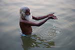 "Indian holy man, ""Sadhu"" bathing and praying in Ganges River;  Varanasi has been a cultural and religious center in northern India for several thousand years, Varanasi, Uttar Pradesh, India --- Model Released"