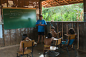 Xingu Indigenous Park, Mato Grosso State, Brazil. Aldeia Ipatse - Kuikuro central village. The Central Karib Indigenous School with indigenous teacher Ibene Kuikuro teaching in Portuguese and the Carib indigenous language.