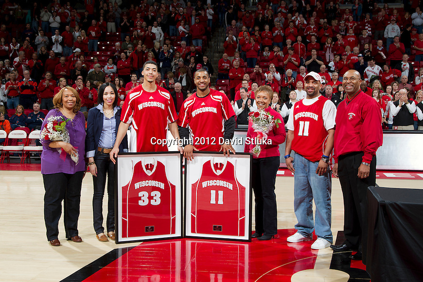 Wisconsin Badgers seniors Rob Wilson (33) and Jordan Taylor (11) pose with their families prior to a Big Ten Conference NCAA college basketball game against the Illinois Fighting Illini on Sunday, March 4, 2012 in Madison, Wisconsin. The Badgers won 70-56. (Photo by David Stluka)