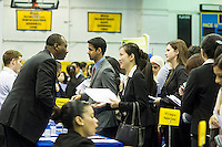 Job seekers attend an internship and job fair at Pace University in New York on Thursday, April 25, 2013.  The US Labor Department reports new claims for unemployment benefits for last week decreased to a seasonably adjusted 339,000. ( © Frances M. Roberts)
