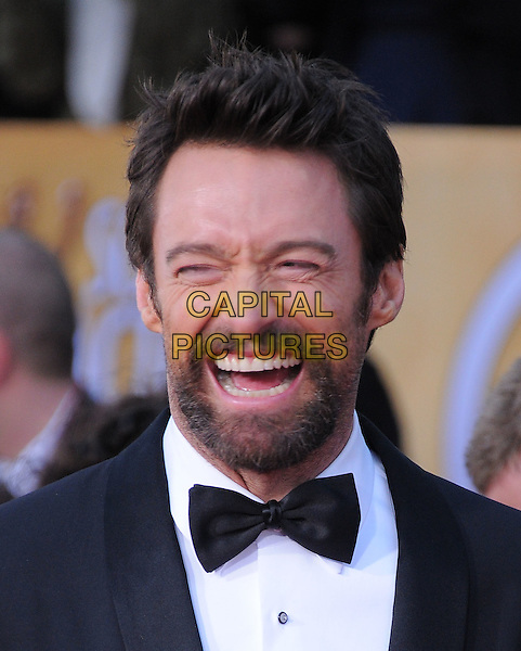 Hugh Jackman.Arrivals at the 19th Annual Screen Actors Guild Awards at the Shrine Auditorium in Los Angeles, California, USA..27th January 2013.SAG SAGs headshot portrait black white bow tie tuxedo smiling laughing mouth open funny.CAP/DVS.©DVS/Capital Pictures.