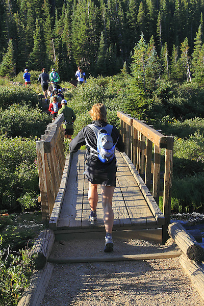 Group of trail runners in the Indian Peaks Wilderness Area, west of Boulder, Colorado, USA.