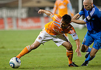 Danny Cruz (5) extends for the ball against Tim Ward (20). The Houston Dynamo defeated the San Jose Earthquakes 1-0 at Buck Shaw Stadium in Santa Clara, California on October 16th, 2010.