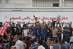 Palestinian Shabab Rafah players celebrate with the trophy after beating Shabab Khan Younis during Super Cup soccer match, at Palestine Stadium, in Gaza City on September 1, 2018. Photo by Mahmoud Ajour