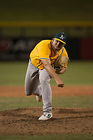 AZL Athletics relief pitcher Dallas Woolfolk (64) follows through on his delivery during an Arizona League game against the AZL Cubs 1 at Sloan Park on June 28, 2018 in Mesa, Arizona. The AZL Athletics defeated the AZL Cubs 1 5-4. (Zachary Lucy/Four Seam Images)