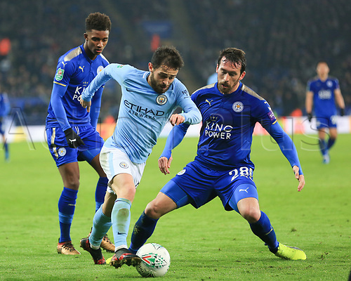 19th December 2017, King Power Stadium, Leicester, England; Carabao Cup quarter-final, Leicester City versus Manchester City; Bernardo Silva of Manchester City passes Christian Fuchs of Leicester City on the wing