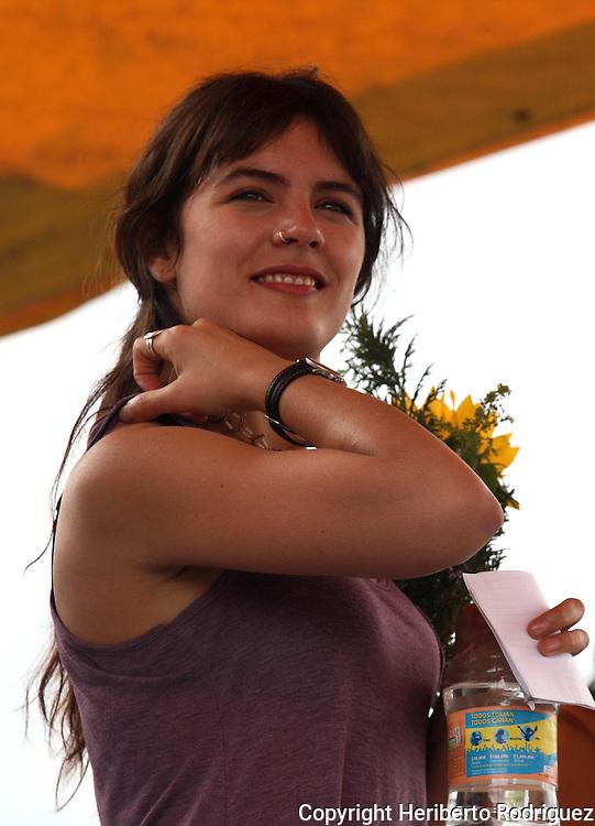Chilean university leader Camila Vallejo smiles while atending the meeting with students of the Metropolitan Autonomous University (UAM) in Mexico City's Xochimilco venue, June 15, 2012. Photo by Heriberto Rodriguez