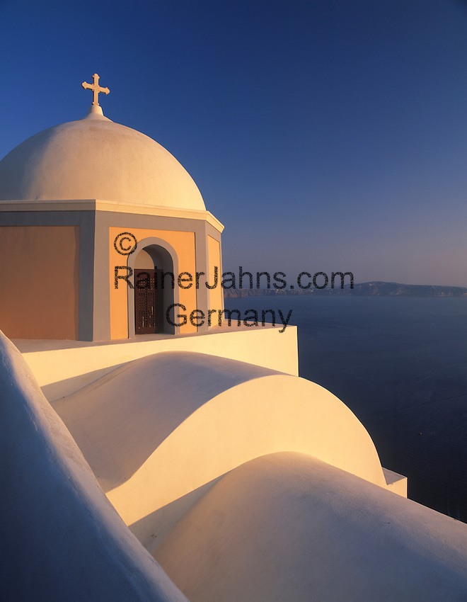 Greece; Cyclades; Santorini; Fira (Thira): Church at dusk and view across the Caldera