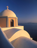 Greece; Cyclades; Santorini; Fira (Thira): Church at dusk and view across the Caldera