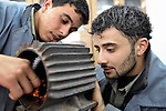 Tawfiq Al-Sagyer (left) and Mahmoud El-Farul (right), both 20 years old, work on an electrical motor in a vocational training center in al-Qarara, in the Gaza Strip. Sponsored by the Near East Council of Churches Committee for Refugee Work, part of the ACT Alliance, the center trains youth in residential and industrial electrical work..