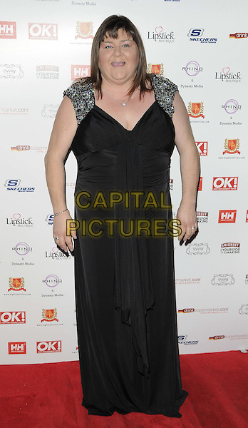 Cheryl Fergison.The OK! magazine Christmas party, Sway Bar, London, England..November 27th, 2012.full length black dress beads beaded embellished jewel encrusted mouth open.CAP/CAN.©Can Nguyen/Capital Pictures.
