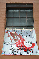 "Phoenix, Arizona - A large banner denouncing the drug war in Mexico where there has been more than 50 thousand dead people was taped on a window behind the A.E. England Building at the Civic Space Park in Downtown Phoenix, where members of the ""Caravan for Peace with Justice and Dignity"" gathered to hold a rally and share testimonies about their dead or missing relatives. The ""Caravan for Peace with Justice and Dignity"" stopped in Phoenix on Wednesday, August 15, 2012 as it travels across the United States as a way to create awareness in the United States about the failed drug war in Mexico that has left more than 70,000 dead. The caravan is led by Mexican poet, essayist, novelist, and journalist Javier Sicilia, whose son Juan Francisco Sicilia Ortega son was brutally murdered along with six other students in Morelos, Mexico by members of a drug cartel on March 28, 2011. In response, Sicilia created the Movement for Peace with Justice and Dignity --popularly known as ¡Ya Estamos Hasta la Madre! or We Have Had It!-- calling for an end the drug cartels bloodshed. Photo by Eduardo Barraza © 2012"
