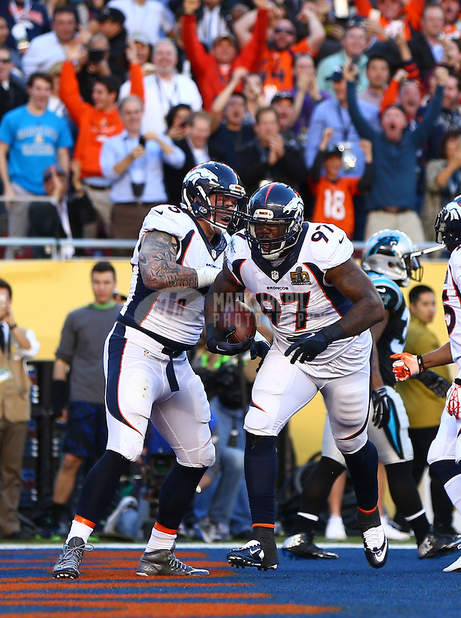 Feb 7, 2016; Santa Clara, CA, USA; Denver Broncos defensive tackle Malik Jackson (97) celebrates a touchdown with defensive end Derek Wolfe (95) against the Carolina Panthers in Super Bowl 50 at Levi's Stadium. Mandatory Credit: Mark J. Rebilas-USA TODAY Sports