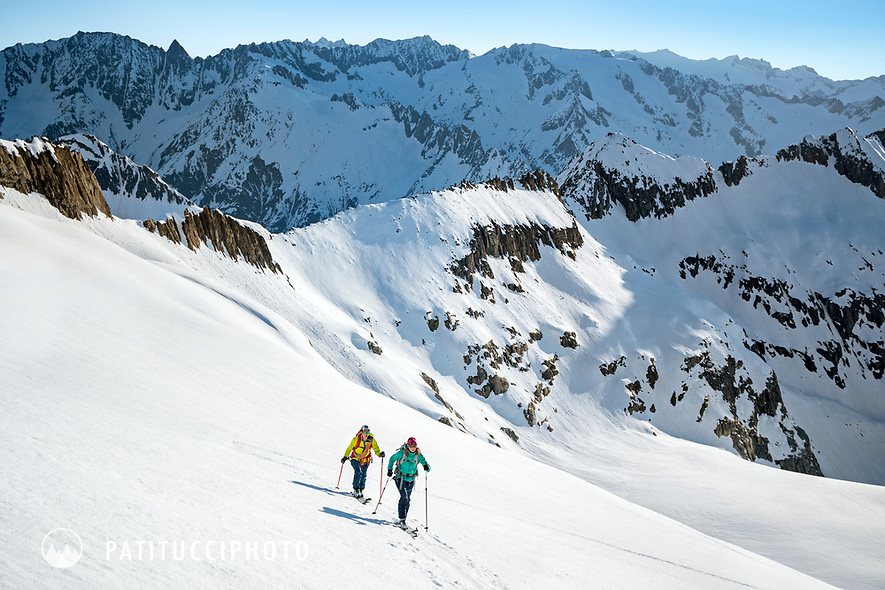 Ski tourers on the way to the Gauli Hut while on the Berner Haute Route, Switzerland.