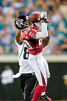 August 19, 2011:  Atlanta Falcons cornerback Brent Grimes (20) breaks up a first quarter pass intended for Jacksonville Jaguars wide receiver Mike Thomas (80) during pre season action between the Jacksonville Jaguars and the Atlanta Falcons at EverBank Field in Jacksonville, Florida.   Jacksonville defeated the Falcons 15-13.........