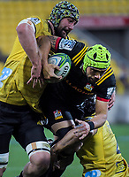 Blade Thomson tackles Charlie Ngatai during the Super Rugby quarterfinal match between the Hurricanes and Chiefs at Westpac Stadium in Wellington, New Zealand on Friday, 20 July 2018. Photo: Dave Lintott / lintottphoto.co.nz