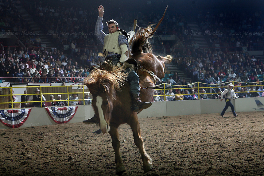 Canadian, Clay Bunney (cq), from Cessford, Alberta holds on to his bronco at the bareback Bronc Riding event at the National Western Rodeo Finals in the Denver Coliseum on Sunday, January 27, 2008..(JAVIER MANZANO / ROCKY MOUNTAIN NEWS).Clay Bunney (cq)....